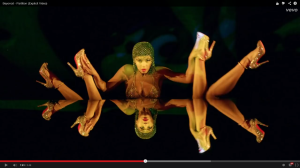 picture of beyonce in partition video dancing with female legs.