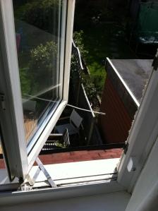 A wide open window with dangerous drop